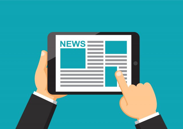 Cartoon imagery of a man using tablet to read the news