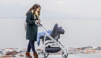 Mother pushing her baby in a pram