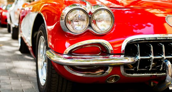 Close up of classic red car headlights